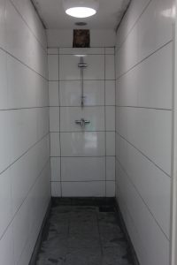 Tiled shower at Cresswell Barn Farm Campsite